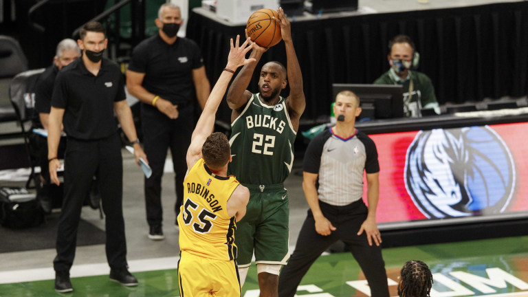 Khris Middleton (22) makes the game winning basket over Miami Heat forward Duncan Robinson (55) with 0.5 seconds to play in overtime of game one in the first round of the 2021 NBA Playoffs at Fiserv Forum. Mandatory Credit: Jeff Hanisch-USA TODAY Sports