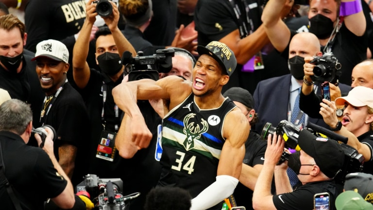 Milwaukee Bucks forward Giannis Antetokounmpo celebrates after winning Game 6 of the 2021 NBA Finals and the championship against the Phoenix Suns at Fiserv Forum.