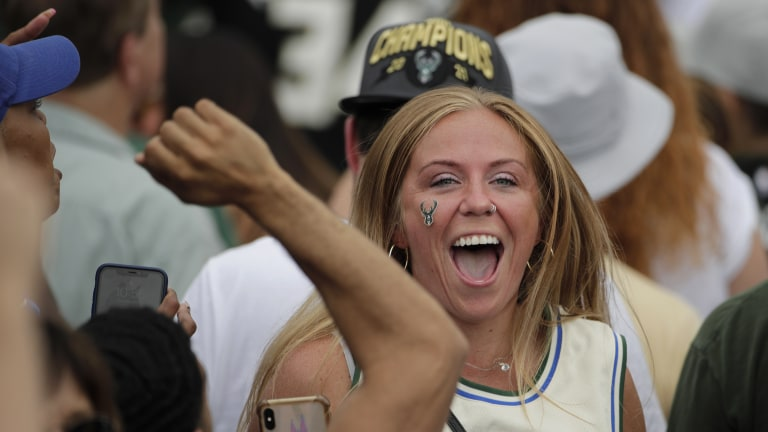 A fan cheers during the parade. (AP Photo/Aaron Gash)