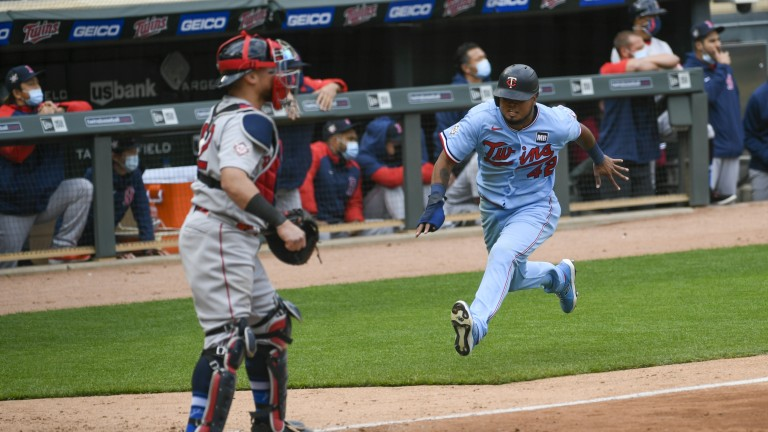 Thursday, April 15: Minnesota Twins' Luis Arraez, right, races home to scores the winning run on a single by Max Kepler as Boston Red Sox catcher Christian Vazquez waits for the throw in the ninth inning of a baseball game.
