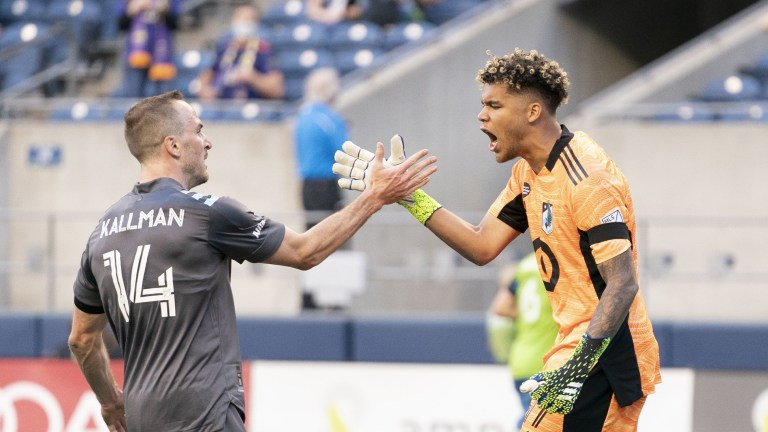 Friday, April 16: Minnesota United FC goalkeeper Dayne St. Clair is congratulated by defender Brent Kallman for making a save against the Seattle Sounders FC during the first half at Lumen Field.
