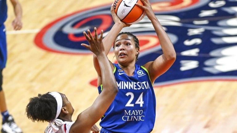 Tuesday, June 8: Minnesota Lynx forward Napheesa Collier shoots over Washington Mystics guard Kiara Leslie.
