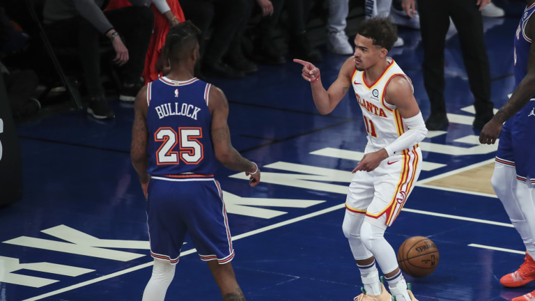 Atlanta Hawks guard Trae Young (11) points to New York Knicks forward Reggie Bullock (25) after scoring in the first quarter of Game 5 of an NBA basketball first-round playoff series Wednesday, June 2, 2021, in New York. (Wendell Cruz/Pool Photo via AP)