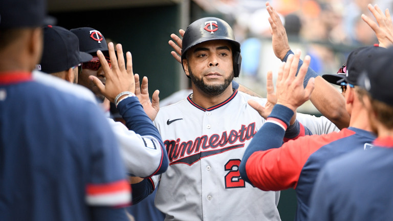 Twins designated hitter Nelson Cruz (23) celebrates his run with teammates during the first inning against the Detroit Tigers at Comerica Park.