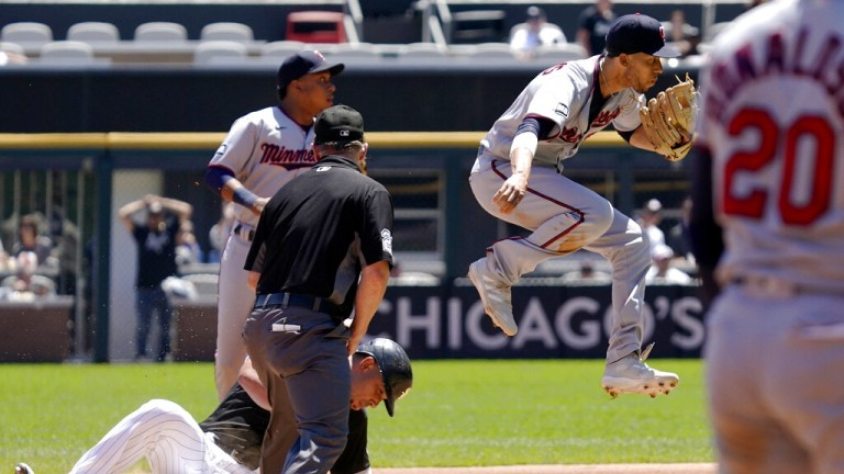 Thursday, July 1: Twins shortstop Andrelton Simmons, right, throws out Chicago White Sox's Yasmani Grandal at first after forcing out Jose Abreu at second.