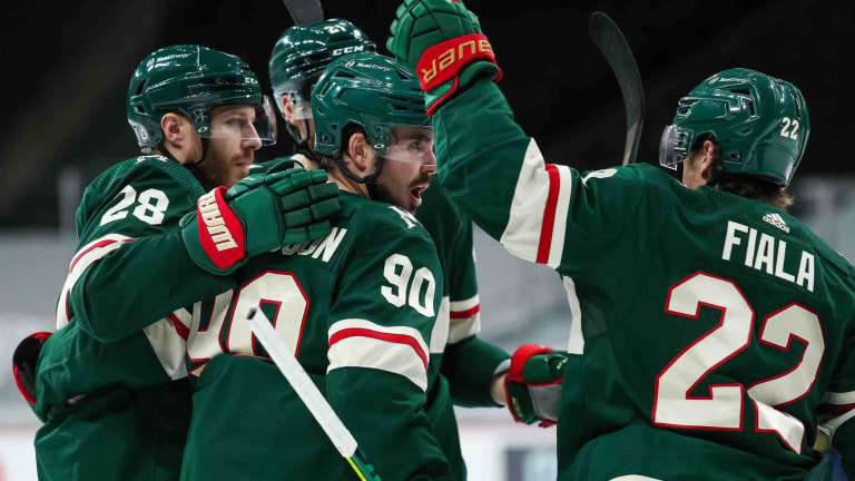 Thursday, March 25: Wild center Marcus Johansson celebrates with teammates after scoring a goal against the St. Louis Blues.