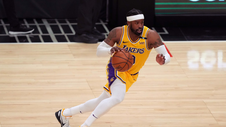 May 6, 2021; Los Angeles, California, USA; Los Angeles Lakers guard Wesley Matthews (9) dribbles the ball against the LA Clippers in the first half at Staples Center. Mandatory Credit: Kirby Lee-USA TODAY Sports