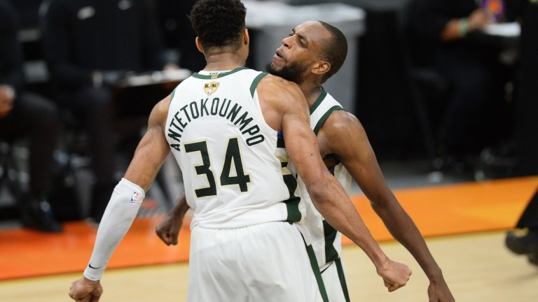 Bucks forward Khris Middleton (22) celebrates with Bucks forward Giannis Antetokounmpo (34) after defeating the Phoenix Suns in Game 5 of the 2021 NBA Finals at Phoenix Suns Arena.