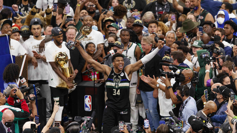 Jul 20, 2021; Milwaukee, Wisconsin, USA; Milwaukee Bucks forward Giannis Antetokounmpo (34) celebrates with the NBA Finals MVP Trophy following the game against the Phoenix Suns following game six of the 2021 NBA Finals at Fiserv Forum. Mandatory Credit: Jeff Hanisch-USA TODAY Sports