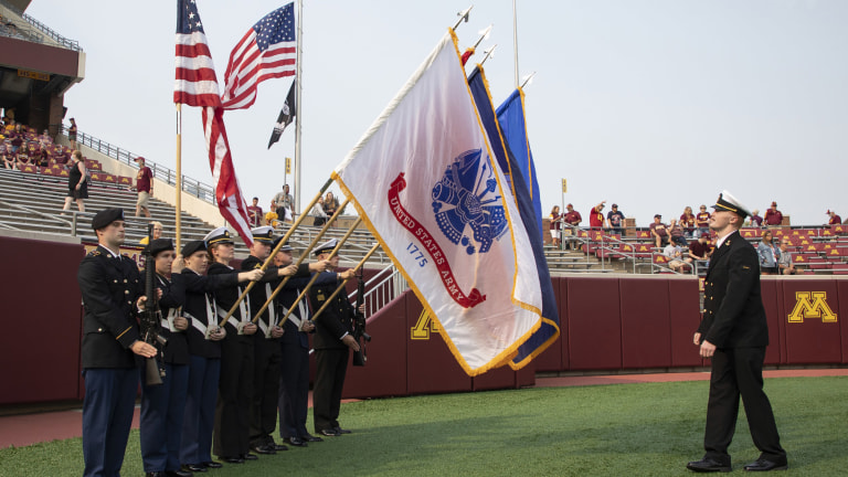 The color guard pregame as the Minnesota Golden Gophers host the Miami (OH) Redhawks at Huntington Bank Stadium.