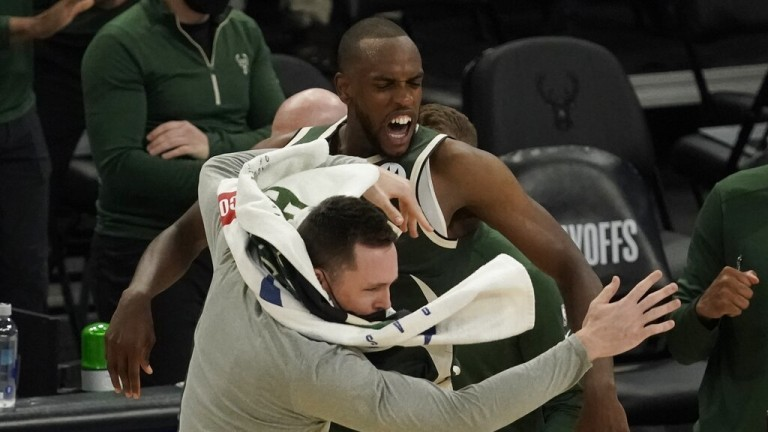 Saturday, May 22: Bucks' Khris Middleton celebrates with Pat Connaughton after hitting a last second shot against the Heat in the first round of the NBA playoffs.