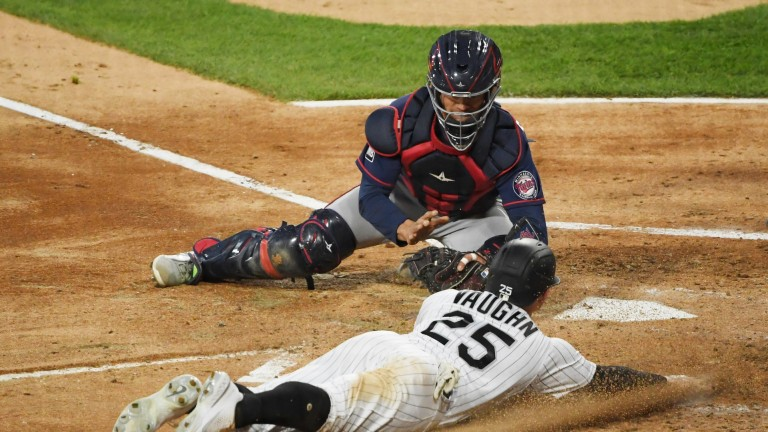 Tuesday, May 11: Twins catcher Ben Rortvedt tags out White Sox first baseman Andrew Vaughn at home plate.