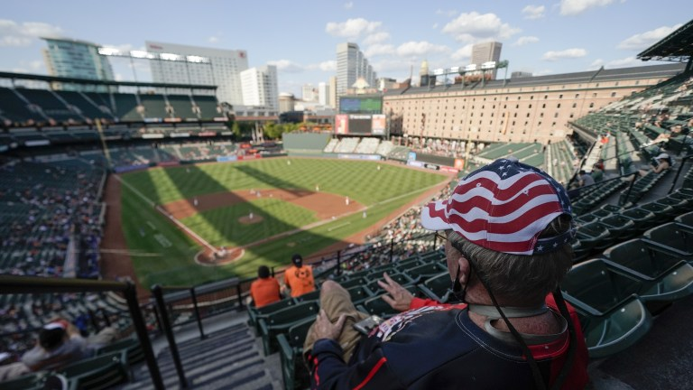 A spectator wears a patriotic hat while watching the second inning of the Orioles-Blue Jays game. (AP Photo/Julio Cortez)