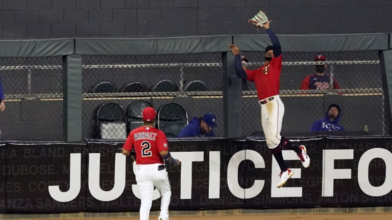 Friday, April 30: Twins outfielder Byron Buxton elevates to make a leaping catching at the warning track against Kansas City.