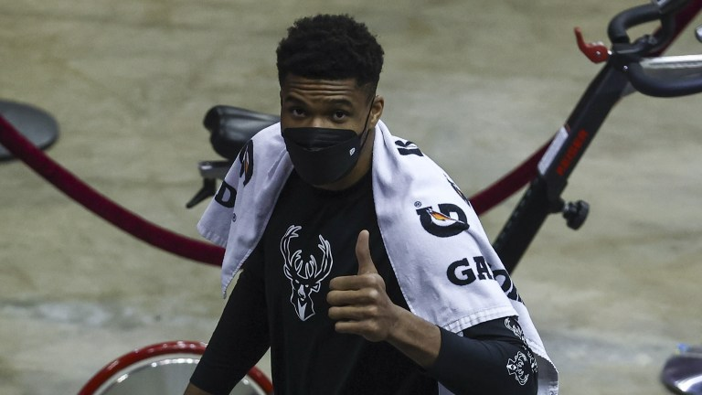 Thursday, April 29: Giannis Antetokounmpo flashes a thumbs-up after exiting the game versus Houston in the first minute with an ankle injury.