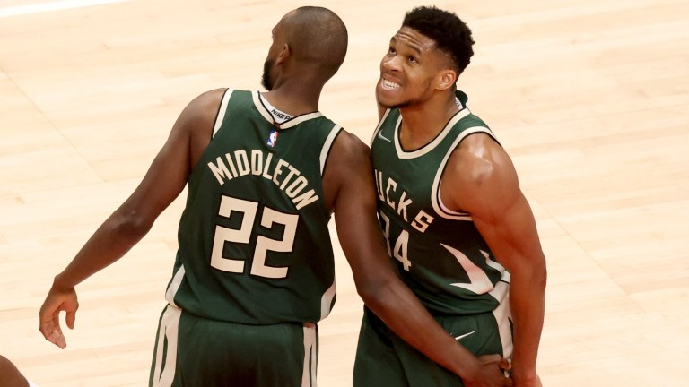 Sunday, April 25: Giannis Antetokounmpo and Khris Middleton converse in the fourth quarter of the Milwaukee Bucks' 111-104 loss to the Atlanta Hawks.