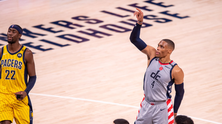 May 8, 2021; Indianapolis, Indiana, USA; Washington Wizards guard Russell Westbrook (4) reacts as hitting the game winning free throw during an overtime period against the Indiana Pacers at Bankers Life Fieldhouse. Mandatory Credit: Doug McSchooler-USA TODAY Sports