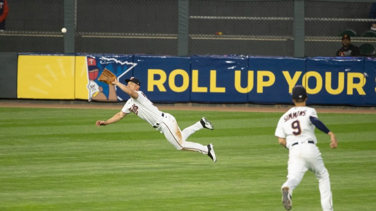 Monday, May 24: Minnesota Twins center fielder Rob Refsnyder dives to make a catch during the team's 8-3 win over Baltimore.