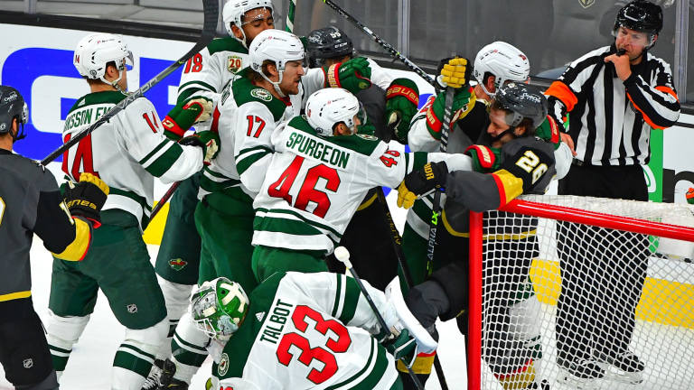 Monday, May 24: Minnesota Wild and Vegas Golden Knights players go at it as goaltender Cam Talbot covers up the puck in Game 5.