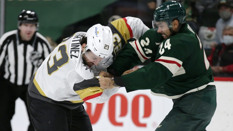 Wednesday, May 26: Minnesota defenseman Matt Dumba mixes it up with Vegas defenseman Alec Martinez during the second period of Game 6.