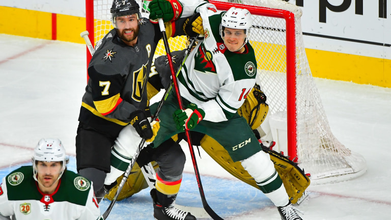 Monday, May 24: Joel Eriksson Ek battles for position in front of the Vegas net during the Minnesota Wild's 4-2 victory.