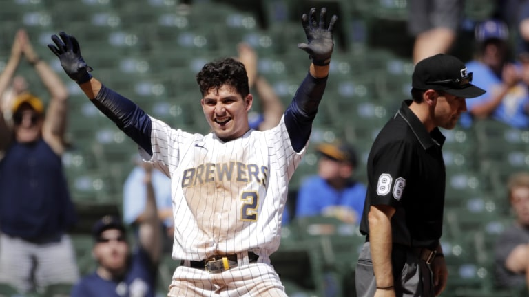 Sunday, June 13: Milwaukee Brewers' Luis Urias smiles as he gestures to the dugout after hitting an RBI triple during the sixth inning of a baseball game against the Pittsburgh Pirates.