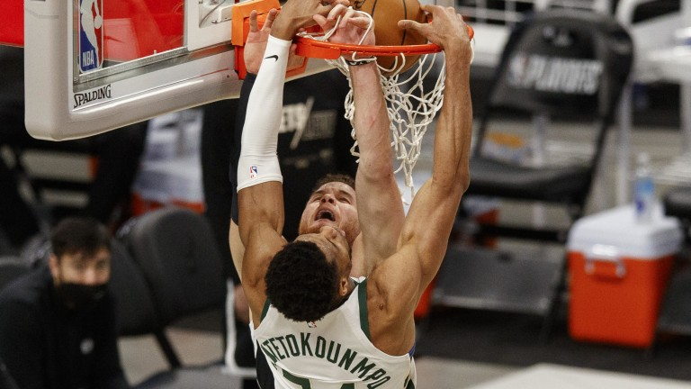 Sunday, June 13: Milwaukee Bucks forward Giannis Antetokounmpo dunks against Brooklyn Nets forward Blake Griffin during the third quarter during game four in the second round of the 2021 NBA Playoffs at Fiserv Forum.