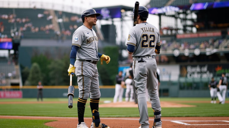 Thursday, June 17: Milwaukee Brewers right fielder Avisail Garcia talks with left fielder Christian Yelich in the first inning against the Colorado Rockies at Coors Field.