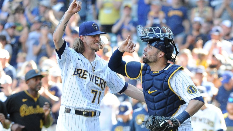 Sunday, June 13: Milwaukee Brewers relief pitcher Josh Hader and Milwaukee Brewers catcher Manny Pina celebrate a 5-2 win over the Pittsburgh Pirates at American Family Field.