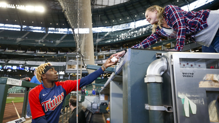 Tuesday, June 15: Minnesota Twins' Nick Gordon signs an autograph for a fan during batting practice before a game against the Seattle Mariners at T-Mobile Park.