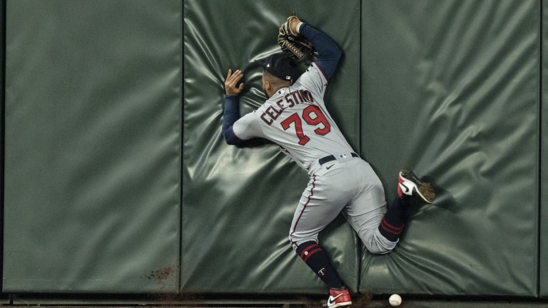 Monday, June 14: Minnesota Twins centerfielder Gilberto Celestino crashes into the wall trying to get to a ball hit for a triple by Seattle Mariners second baseman Dylan Moore during the fifth inning of a game at T-Mobile Park.