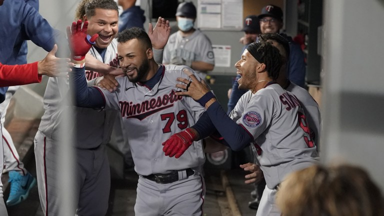 Monday, June 14: Minnesota Twins' Gilberto Celestino is greeted by teammates Willians Astudillo and Andrelton Simmons after Celestino, who made his major-league debut on June 2, hit his first MLB career home run during the fourth inning of a baseball game against the Seattle Mariners.