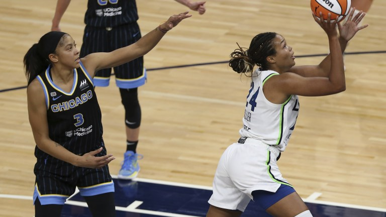 Tuesday, June 15: Minnesota Lynx's Napheesa Collier goes up to the basket past Chicago Sky's Candace Parker during the second half of a WNBA basketball game.