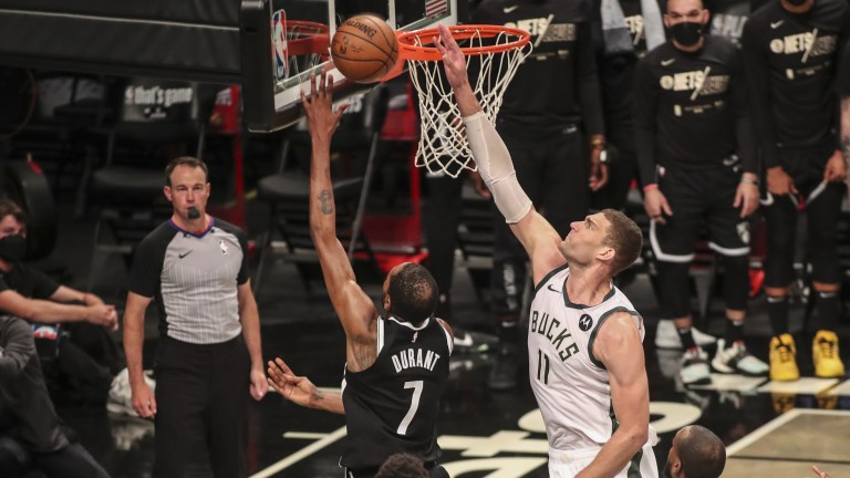 Saturday, June 19: Milwaukee Bucks center Brook Lopez blocks a shot by Brooklyn Nets forward Kevin Durant in overtime during game seven in the second round of the 2021 NBA Playoffs at Barclays Center.