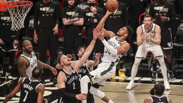 Saturday, June 19: Milwaukee Bucks forward Giannis Antetokounmpo puts up a one handed jump shot over Brooklyn Nets forward Blake Griffin in the second quarter during game seven in the second round of the 2021 NBA Playoffs at Barclays Center.