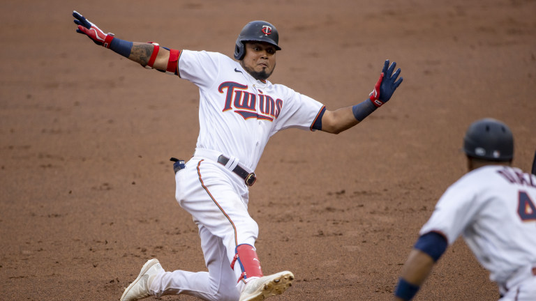 Friday, June 25: Minnesota Twins left fielder Luis Arraez slides into third base for a triple in the first inning against the Cleveland Indians at Target Field.