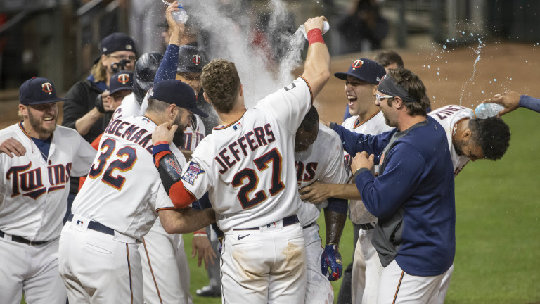 Monday, June 21: Minnesota Twins first baseman Miguel Sano celebrates with teammates after hitting a walk off home run in the twelfth inning against the Cincinnati Reds at Target Field.