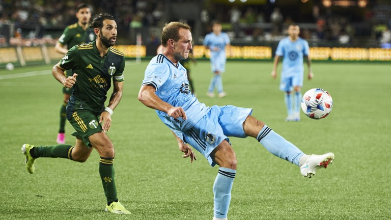 Saturday, June 26: Minnesota United defender Chase Gasper clears the ball away from Portland Timbers midfielder Diego Valeri during the second half at Providence Park. Minnesota United won 1-0.