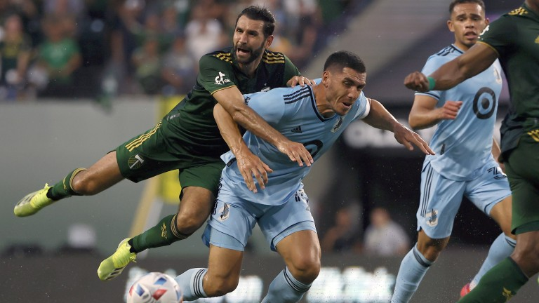 Saturday, June 26: Portland Timbers midfielder Diego Valeri and Minnesota United FC defender Michael Boxall collide during the first half at Providence Park.