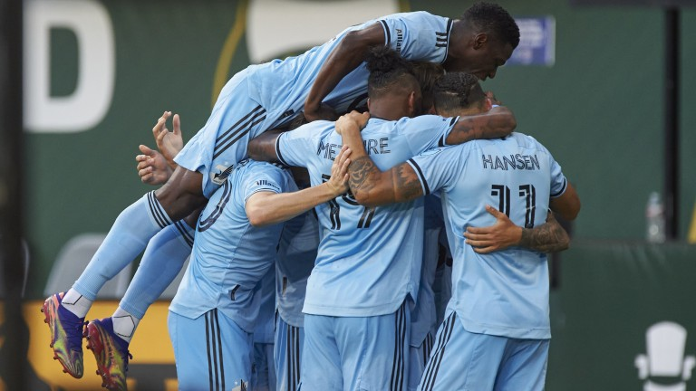Saturday, June 26: Minnesota United midfielder Adrien Hunou celebrates with teammates after scoring a goal in the first half against the Portland Timbers at Providence Park.