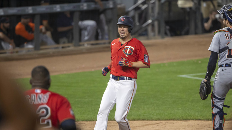 Monday, July 26: Minnesota Twins pinch runner Kenta Maeda scores the winning run in the tenth inning against the Detroit Tigers at Target Field.