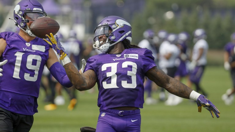 Friday, July 30: Minnesota Vikings running back Dalvin Cook tosses the ball back to wide receiver Adam Thielen after a long run through the defense during NFL football training camp.