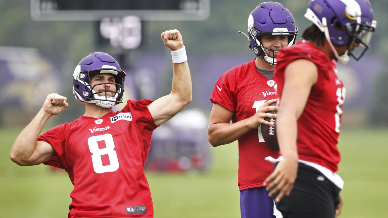 Friday, July 30: Minnesota Vikings quarterback Kirk Cousins responds to the crowd, next to quarterbacks Nate Stanley and Kellen Mond during NFL football training camp.