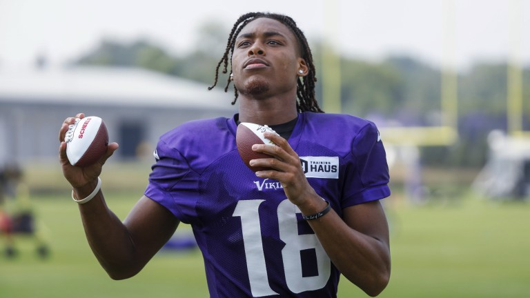 Friday, July 30: Minnesota Vikings wide receiver Justin Jefferson tosses autographed footballs to fans during NFL football training camp.