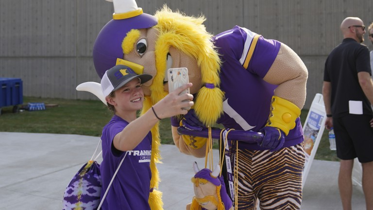 Saturday, July 31: Viktor the mascot poses for a young fan's selfie during the Minnesota Vikings' NFL football training camp.