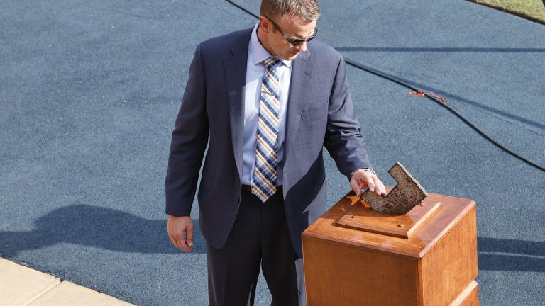 Auburn Tigers head coach Bryan Harsin touches a piece of steel from the World Trade Center before the game against the Alabama State Hornets at Jordan-Hare Stadium. (John Reed-USA TODAY Sports)
