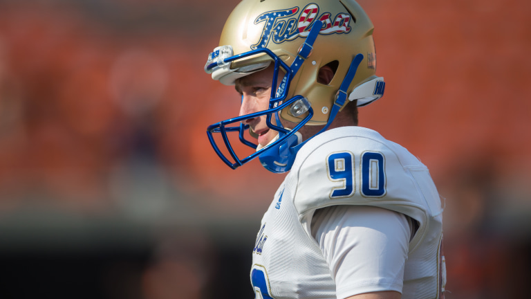 Tulsa Golden Hurricane place kicker Zack Long (90) wears a helmet with an American flag decorated Tulsa logo before the game against the Oklahoma State Cowboys at Boone Pickens Stadium. (Brett Rojo-USA TODAY Sports)