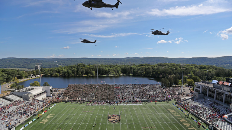 U.S. Army UH-60 Black Hawk helicopters perform a flyover before a game between the Army Black Knights and the Western Kentucky Hilltoppers before the first half at Michie Stadium. (Danny Wild-USA TODAY Sports)