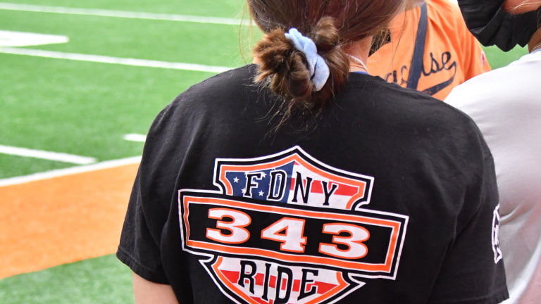 A fan wears a memorial shirt prior to a game between the Syracuse Orange and the Rutgers Scarlet Knights at the Carrier Dome. (Mark Konezny-USA TODAY Sports)