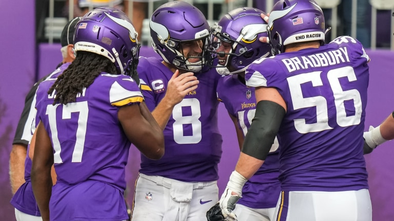 Minnesota Vikings wide receiver Justin Jefferson celebrates a touchdown with quarterback Kirk Cousins during the second quarter against Seattle Seahawks at U.S. Bank Stadium.